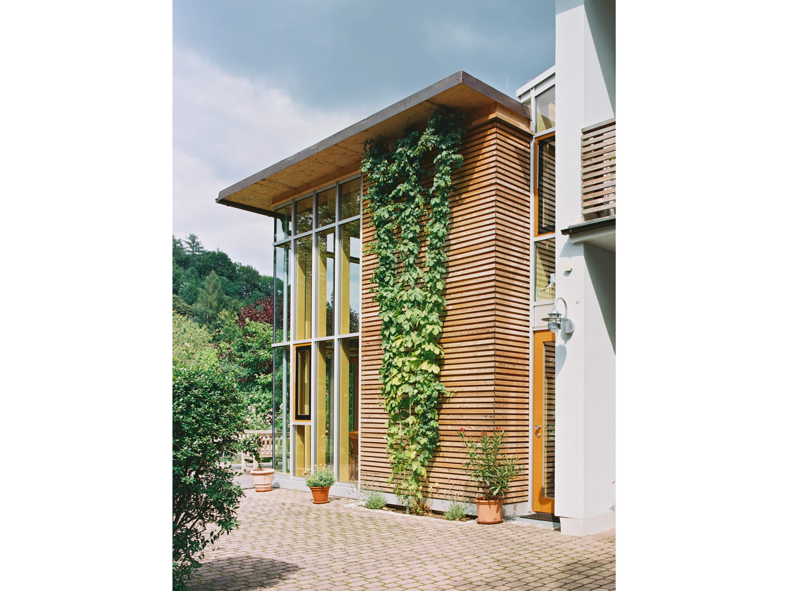 Anbau Wohnhaus Glas Holz Garten